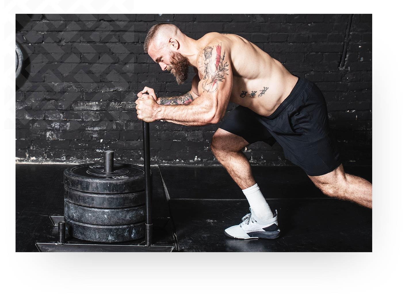 Tattooed Man Lifting