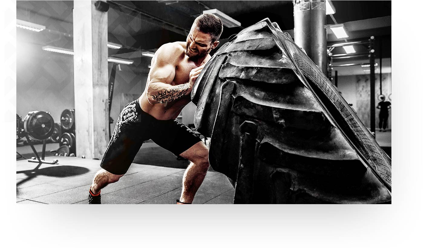 Man Lifting Big Tire